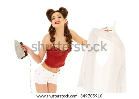 Young woman with shirt and iron on a white background. Housekeeping. - stock photo