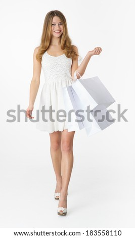 Young woman with shopping bag on white background - stock photo