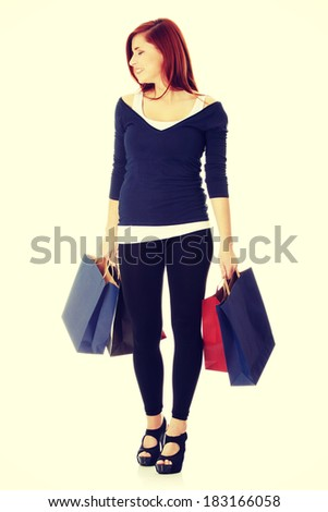 Young woman with shopping bags - stock photo