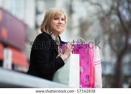 Young woman with shopping bags. - stock photo