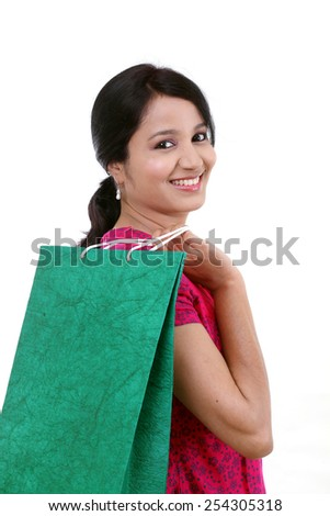 Young woman with shopping bags against white background - stock photo