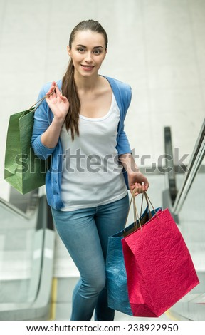 Young woman with shopping bags at fashionable store. - stock photo