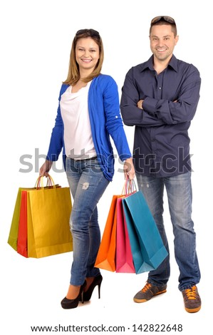young woman with shopping bags isolated in white