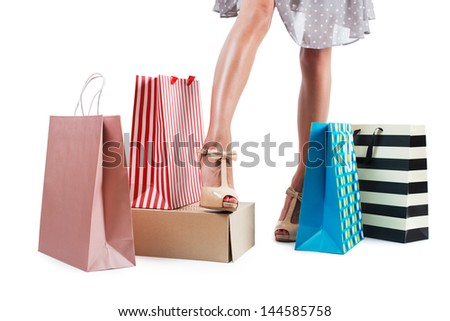 Young woman with shopping bags isolated white background