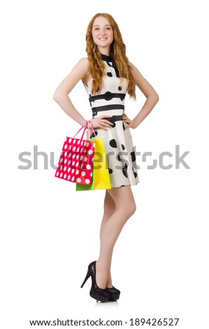 Young woman with shopping bags on white