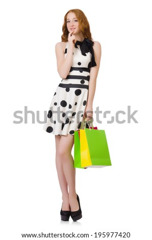 Young woman with shopping bags on white - stock photo
