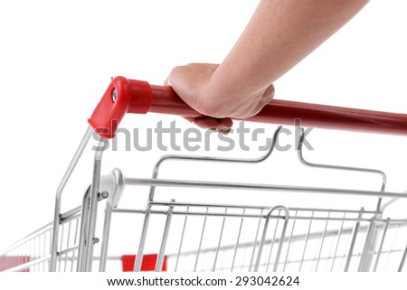 Young woman with shopping cart close up - stock photo