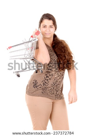 young woman with shopping cart isolated in white background - stock photo