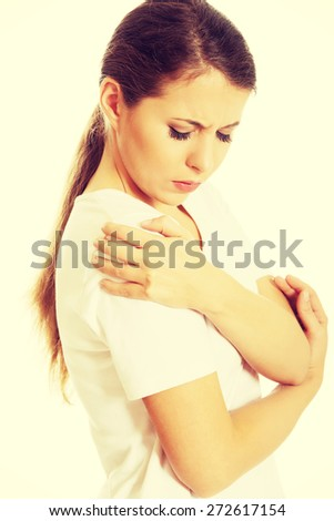 Young woman with shoulder pain - stock photo