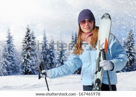 Young woman with ski in winter time - stock photo