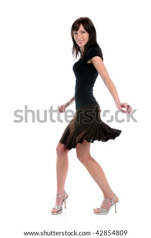 Young woman with skirt and high heels dancing - stock photo