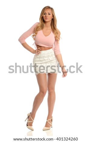 Young Woman with skirt and high heels isolated on a white background - stock photo