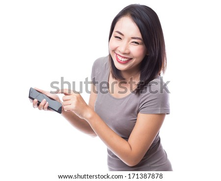 Young woman with smartphone on white background - stock photo