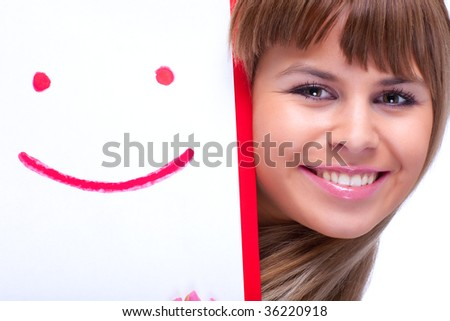 Young woman with smile symbol. On white. - stock photo