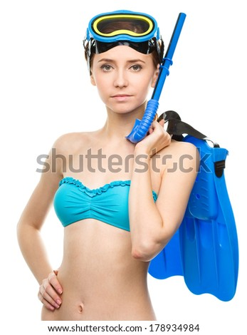 Young woman with snorkel equipment, isolated over white - stock photo