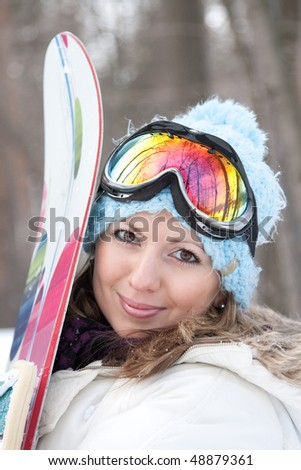 Young woman with snowboard - stock photo