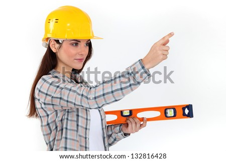 Young woman with spirit level - stock photo