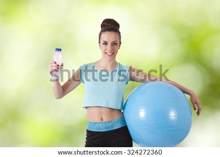 young woman with sports clothing - stock photo