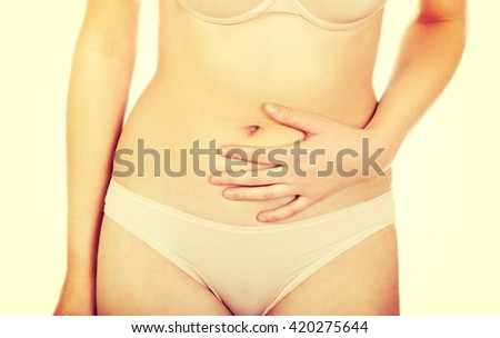 Young woman with stomach pain  - stock photo