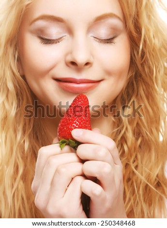 young woman with strawberry on the white background - stock photo