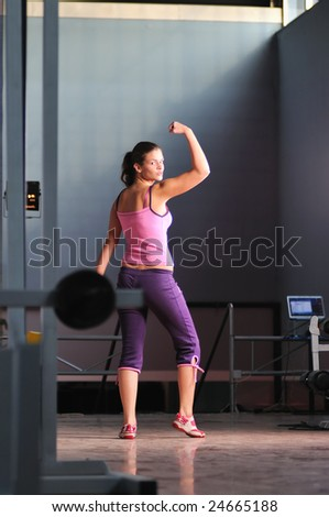 young woman with strong arms rising hands in air and representing their streinght and vitality