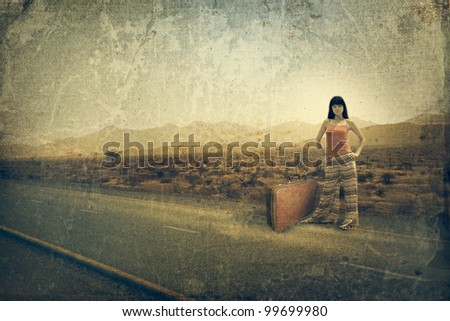 Young woman with suitcase on the road. Old style image
