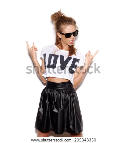 Young woman with sunglasses giving the Rock and Roll sign.  White background, not isolated - stock photo