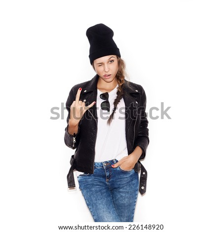 Young woman with sunglasses giving the Rock and Roll sign.  White background, not isolated