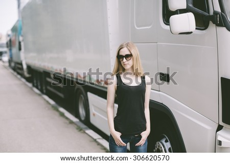 young woman with sunglasses near white cargo truck  - stock photo