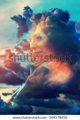 Young woman with sunset clouds concept portrait. Double exposure technique. - stock photo