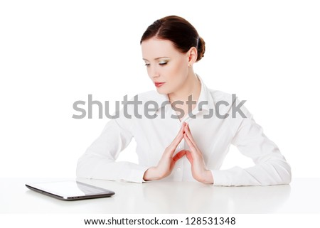 Young woman with tablet computer, white background - stock photo