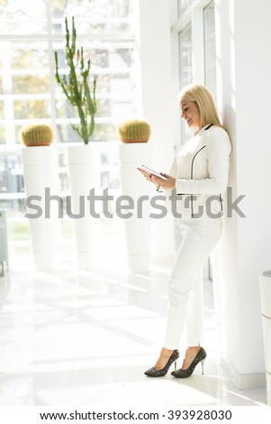 Young woman with tablet in the office