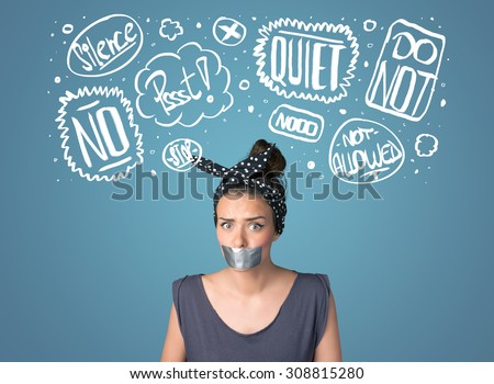 Young woman with taped mouth and white drawn thought clouds around her head  - stock photo