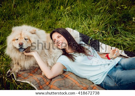 Young woman with the dogs in the park. - stock photo