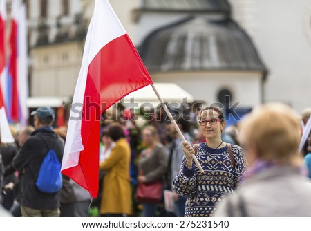 Young woman with the Polish flag in the street. - stock photo