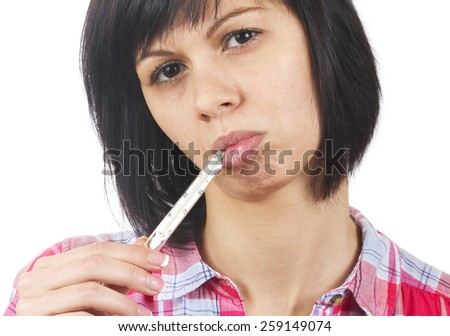 Young woman with thermometer in mouth - stock photo