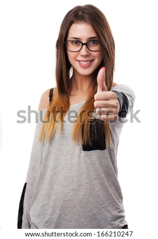 young woman with thumb up isolated on white background