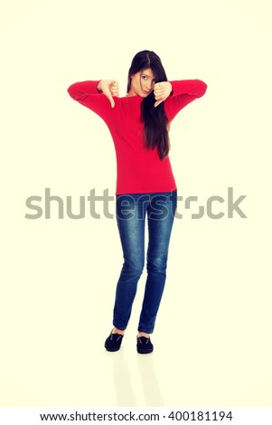 Young woman with thumbs down. - stock photo