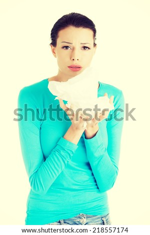 Young woman with tissue - sneezing , isolated on white - stock photo