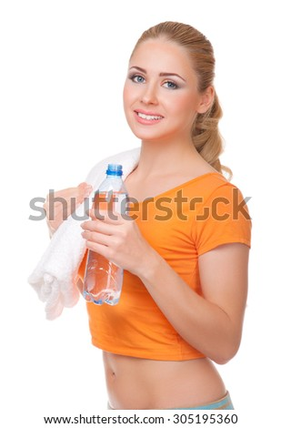 Young woman with towel and bottle isolated
