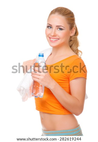 Young woman with towel and water bottle isolated