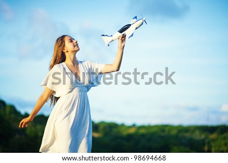 young woman with toy airplane