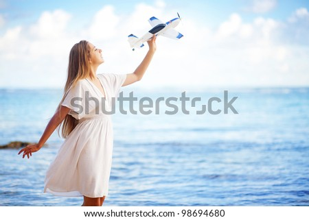 young woman with toy airplane - stock photo