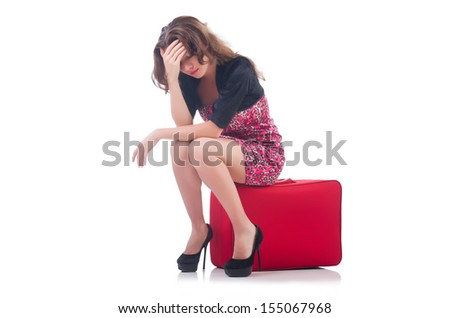 Young woman with travel suitcase - stock photo