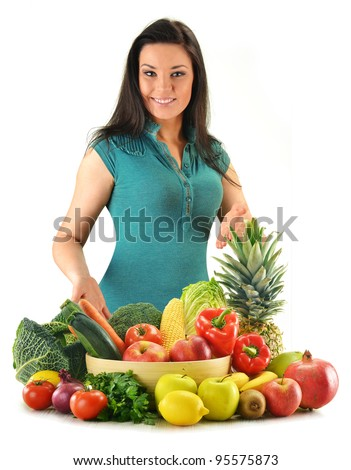Young woman with variety of fresh vegetables and fruits isolated on white