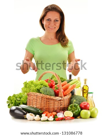 Young woman with variety of vegetables isolated on white background