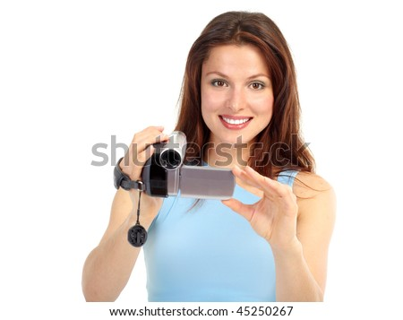 Young woman with video camera. Isolated over white background