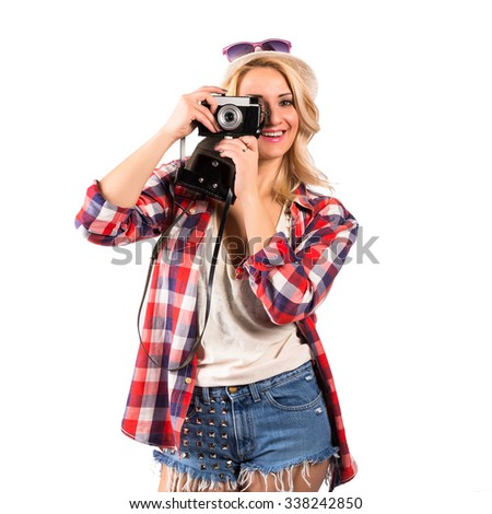 Young woman with vintage camera. Teenager girl dancing against isolated white background