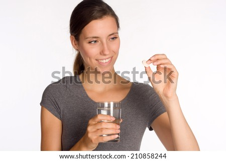Young woman with water an medecine