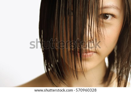 Young woman with wet hair, head shot